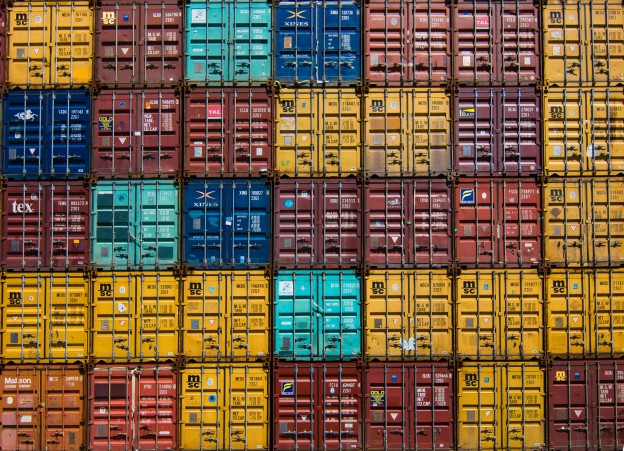 Shipping containers stacked on top of one another