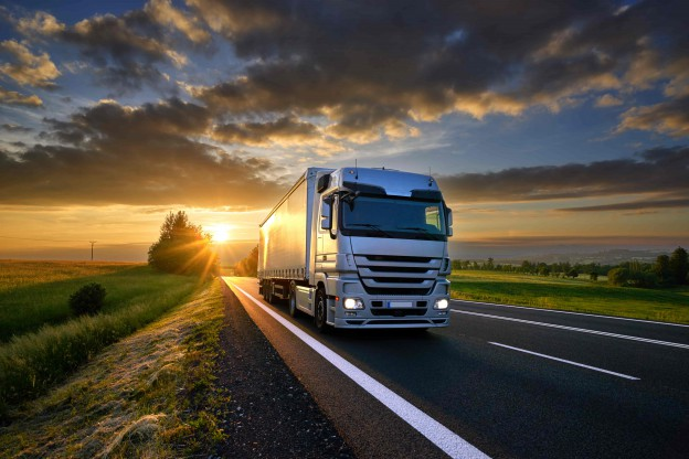 Freight truck driving down highway